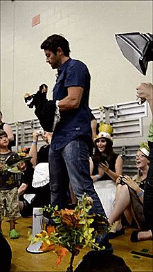 Misha puts on his maid costume for GISHWHES 2014.  I love how West is standing there just like no big deal.  :)