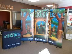 Kick cover trade show display.  Three retractables and table cover