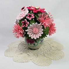 A Pink Quilled Paper Art 3-D Bouquet Floral Arrangement Comes in an Antique Floral Motif Salt Shaker. Makes a Great Gift.