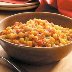 "Spanish Hominy Recipe -""I received this recipe from a good friend who is a fabulous cook,"" remarks Donna Brockett of Kingfisher, Oklahoma. The colorful side dish gets its zesty flavor from spicy canned tomatoes with green chilies. Hominy Recipes, Crockpot Recipes, Cooking Recipes, Healthy Recipes, Mexican Food Recipes, Ethnic Recipes, How To Grill Steak, Frugal Meals, Vegetable Side Dishes"