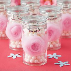Send your guests home with these trendy tulle rosette wrapped jars filled with your favorite tre...