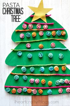 This pinwheel pasta Christmas Tree Craft is fun for kids of all ages. Great preschool craft, Christmas craft, winter kids craft.