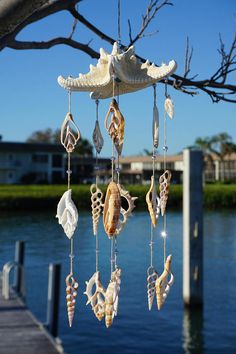 This starfish mobile is sure to impress; made with a real starfish, seashells, Austrian crystals, and twine. Looking for a great hostess or housewarming gift? This sweet handmade mobile can be hung in your office, home, nursery, or even on your patio to remind you of sunny days on the