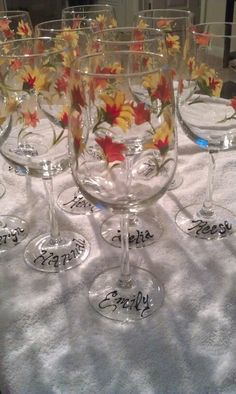 Hand painted wine glasses perfect for a fall wedding!