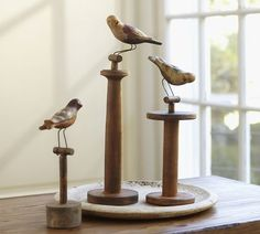 Table decor ~ Bird Topped Spools. These are from Pottery Barn but could use inspiration with your own vintage finds.