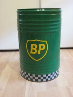 """Used oil barrel by """"BP"""". There are small dents, scratches and a minimal amount of oil remnants is still inside the barrel. Bp Gas, John Deere Decor, Westerns, Ss Lazio, Oil Barrel, Barrel Furniture, Oil Drum, Gas Pumps, Mineral Oil"""