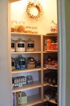 Nicely organized and labeled. Also love that there is some decoration in this pantry. Functional and beautiful!