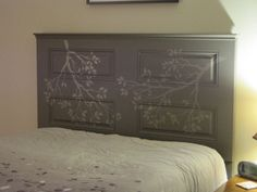 Headboard out of a door and some crown molding and paint!