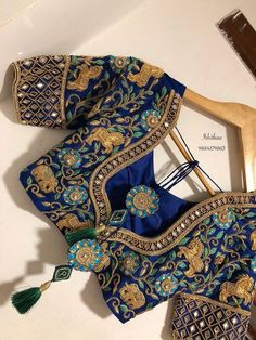 Love this deep blue embroidered sari blouse back design style. Click on picture to see 50 more saree bridal blouse designs. #Frugal2Fab   -  #blousedesigns #blousedesignsBridal #blousedesignsHighNeck #blousedesignsPattu