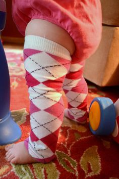 "Might have to try these for the new little one - we have hardwood floors, this might make crawling a little easier (have to try with a less ""girly"" color though).  #DIY Baby legwarmers out of knee socks"