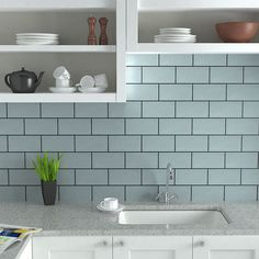 Metro tiles are a popular modern style for kitchens. Shown here: Mahon Duck Egg blue kitchen tiles | londontile.co.uk