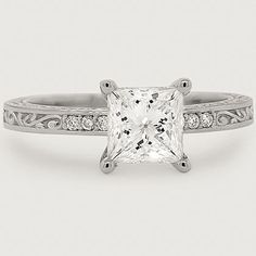 Love the antique feel of this stunning diamond engagement ring.