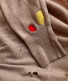 Thriftiness as art: mending your wool sweater with needle felted patches.