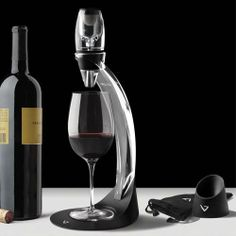 Get the full experience your wine has to offer using the Vinturi Deluxe Red Wine Aerator Set. The set features Vinturi's impressive aerator equipped with a sediment filter screen. In addition, you'll receive a sleek no drip stand that offers a hassle-free pouring and aerating process.