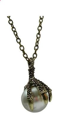 Bronze tone claw and Ball necklace.  Chain necklace with adjustable lobster clasp closure
