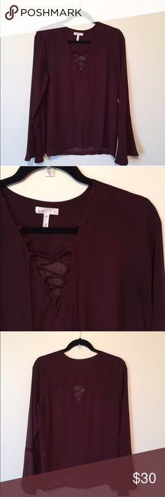 Sale!! Leith Lace Up Bell Sleeve top Retail $65. Maroon lace up top with bell sleeve. Super on trend. Slit in front. Slit at sides. Measurements according to brand: M= 8/10 bust 36, waist 29, hips 39 Leith Tops Blouses