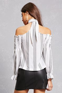A crepe woven top featuring an allover abstract stripe pattern, a self-tie choker neckline, an off-the-shoulder design, smocked bust, and long sleeves with elasticized cuffs. This is an independent brand and not a Forever 21 branded item.