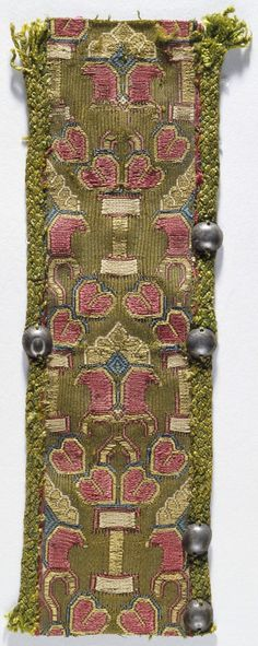 """""""Ribbon - Great Britain, Saxon, circa 9th century - Tablet weave gold metal thread - 2 x 6 1/2 in. (5.08 x 16.51 cm)"""" -- Los Angeles County Museum of Art, Costume and Textiles Collection; """"Not currently on public view."""""""