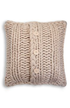This chunky, oversized knit accent pillow lends a cozy and charming look to the living room.