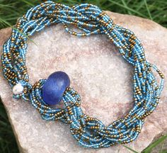Blue and Gold Bead Necklace Blue Necklace Beaded by AfrowearHouse #beadedjewelry #africanbeads #glassbeads #beads #bluebeads #bluenecklace