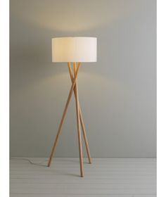 A striking Lansbury wooden floor lamp base with cross framed, tripod style solid ash legs. Wooden Tripod Floor Lamp, Wooden Lamp, Floor Lamp Base, Cool Floor Lamps, Decorative Floor Lamps, Mid Century Modern Lighting, Room Lamp, Unique Lamps, Wooden Flooring