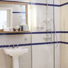 Mosaic tiles have moved on leaps and bounds in recent years, and are no longer limited to the usual design styles. Shaped like bricks, these tiles have been given a modern twist, but the look remains classic with a combination of blue and white.