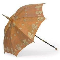 A PARASOL early 19th Century with pagoda shade and horn handle carved with a momento of Princess Charlotte