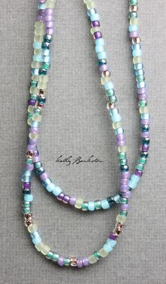 Jewelry Beaded Multicolor blue purple, gold and teal glass seed bead necklace. All the colors of a summer garden! Very pretty mixture of beads. This listing is for a single or glass seed bead necklace. Seed Bead Necklace, Seed Bead Bracelets, Seed Bead Jewelry, Diy Necklace, Wire Jewelry, Jewelry Crafts, Beaded Jewelry, Jewelery, Handmade Jewelry