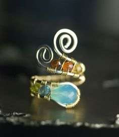 Gorgeous wire wrapped ring! Inspiration.