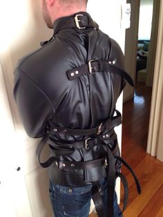 """shortleathersub: """"Today, I had the amazing privilege of being the first slave to experience being restrained in Sir leatherbdsm's beautiful new straightjacket from Mr S Leather """""""