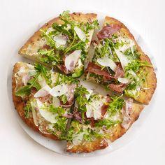 Pizza integral de prosciutto e rúcula