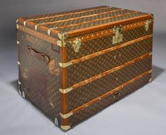 Vintage Louis Vuitton Trunk, circa 1920.   Not particularly a LV fan, but this could double as a very cool coffee table, non?