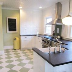 Green and white checker floor at an angle--could do with paint and distress look instead of linoleum