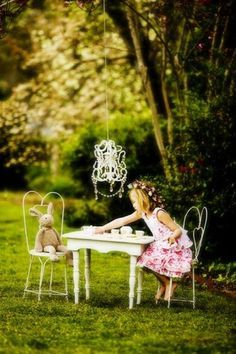 Cute little princess, had a family game, she and the bear at picnic.