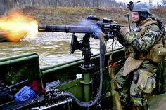 Bryan Weyers    U.S. Navy Petty Officer 3rd Class Geoffrey Martin, assigned to Riverine Squadron 1, fires a GAU-17A gun from the bow of a riverine assault boat during live-fire battle drills on Fort Knox, Ky., March 28, 2010