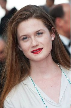 Bonnie Wright shows off her beautiful, effortless hair and bright red lips.