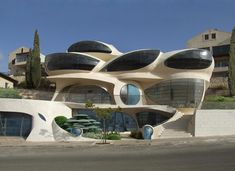 Futuristic free-shaped structure by Architect Ephraim-Henry Pavie, Biomorphic House. Hand made green house, soft and sensitive biomorphic architecture for a magical environment. The Biomorphic House is facing the Mediterranean Sea from its 1000-meters high, the panoramic bay windows have been shaped like amazing sunglasses overlooking the sea.