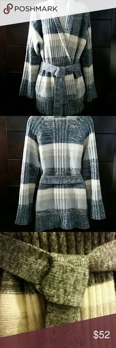 """Neiman Marcus cashmere cardigan sweater This soft & cozy sweater is in great condition. There are no holes, only some little lint balls but nothing major. The label reads """"S"""" but the sweater size runs big...I wear a size 12 and it fits me comfortably. Greys, off white and light blue grey colors Neiman Marcus Sweaters Cardigans"""