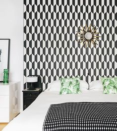 In Madrid, Gutsy Design Wakes Up a Century-Old Pied-à-Terre, Design*Sponge -  Cole & Son wallpaper and bedside lamps from the 1950s decorate Susana and José's bedroom.