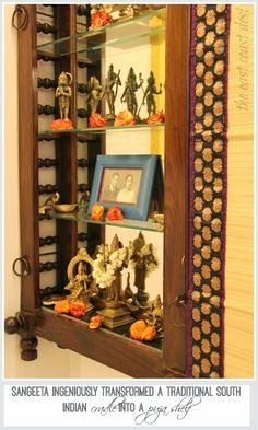 Cradle as a shelf. Also in the picture, vintage saree borders up-cycled to create one of a kind roman shade !