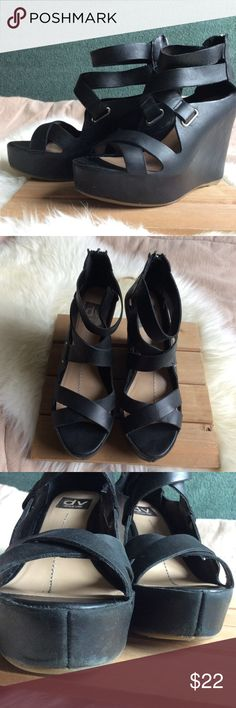 "Dolce Vita Black Leather Wedges Sexy yet comfortable shoes! Gently used.. signs of wear.. scuff marks on front of right (3rd pic) and on backs and sides of both shoes (4th pic). Size 7M. Back zippers.  Heel height: 4 1/2"" (4th & 5th pics). Made in China.  Reasonable offers welcome! (Chart at top of my closet) Lowball offers will be countered with my lowest acceptable price. Ask all questions before purchasing. Additional pics provided upon request. No trades. All sales are final. DV by Dolce…"