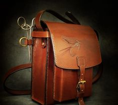 Handmade leather bag, carved with fly fishing theme. We can develop custom models to suit our customers needs. Gifts For Husband, Gifts For Father, Leather Bags Handmade, Leather Craft, Fly Fishing Bag, Fishing Rods And Reels, Fish In A Bag, Fishing Accessories, Fly Rods