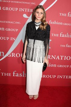 Shop your own closet first for pieces that can be completely transformed when worn together. Follow Olivia Palermo's lead with a fringe accent piece that's layered over a plain, white maxi-dress.