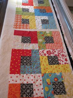 Charm square packs. I might have more than a couple laying around here. Sometimes I buy them with a project in mind, or I find them discounted because the fabric line is running out by the time I d...