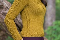 """Kitra means """"crowned one,"""" and the beautiful name reflects the crown of cables entwined with the yoke of this design. Kitra evokes Medieval Kingdoms and the rhythms of the woods in which the royalty hunted. It was designed with Shibui Dune, a mix of baby camel and silk forming a deeply hued yarn that knits into a rich fabric without losing its natural roots. This sweater isroyalenough for your special affairs and natural enough for daily use."""