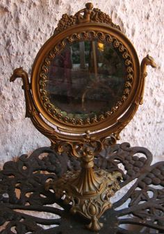 This is a great victotian mirror,Great for the boufoir or just to set out on a victorian table. It is made out of cast iron and at some point long