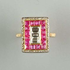 An art deco ruby and diamond panel ring,
