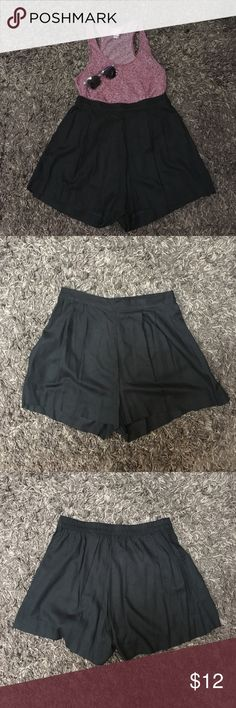 Black shorts Brand new black shorts with an elastic band in the back. They can be worn as high waisted. Please see photos for more detail.  **shirt and sunglasses are just in the photo and are not for sale** H&M Shorts