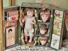 Dolls in a Box.  Creepy little doll heads.