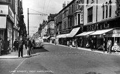 Another view of a bustling Lynn Street with a local policeman keeping an eye on the photographer. Some of the shops in this view include F.W.Woolworth, Hardy & Co., True-Form, Sams and Woodhouse. The registration of the parked car is EF 8670.